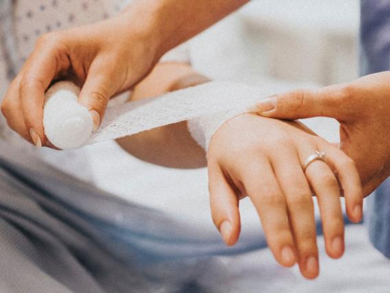 nurse bandaging woman's arm