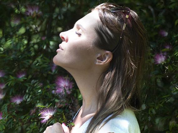 woman standing among flowers